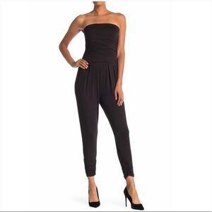 Anthropologie Black strapless jumpsuit w/pockets M